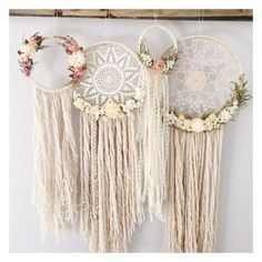 knit doily with dried flowers and hanging strands of wool, some braided
