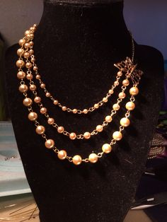Champagne pearls, part of a trio made for bridesmaids. The butterfly is the clasp!!