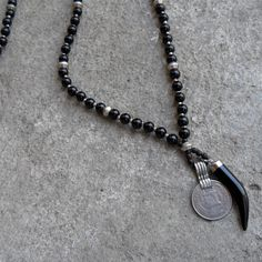 Patience- Genuine onyx gemstone, stainless steel, and genuine Onyx Italian horn necklace