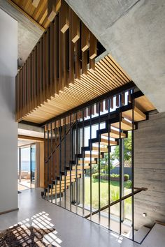 Image 3 of 36 from gallery of Clifton House / Malan Vorster Architecture Interior Design. Photograph by Adam Letch Cedar Shutters, Wooden Shutters, Concrete Building Blocks, Clifton Houses, Chula, Indoor Outdoor Living, Staircase Design, Stairways, Interior Architecture