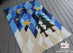Made by Jenni and machine quilted by Natalia Bonner of www.piecenquilt.com.  I think this one is so fun, I love outdoorsy quilts and I want to make one like this one on a wintry day!