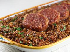 Traditional Italian NYE dish: Braised lentils with cotechino is a wonderful Italian dish that is historically served on New Year's Eve or New Year's Day. The round shape of the lentils represent coins which is supposed to bring prosperity for the upcoming year.