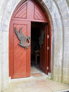 The beautiful doors of St. Columba's, Drumcliffe, Co. Sligo, Ireland - with winged handles, even.