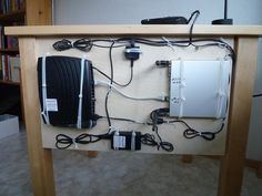 Decluttering wires.  A peg board behind the table.  Excellent. Source: http://www.reddit.com/r/declutter/comments/1jn2c4/decluttered_my_desk/