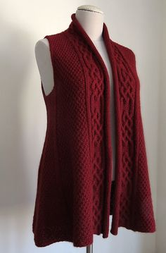 Versatile, wearable, moss stitch vest with lots of striking technical details and rather unusual construction.