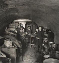 Roman Vishniac. Basement home of a porter & his family, Warsaw 1935-8. R.V. Archive