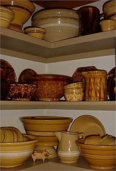 Collection of Yellow Ware, Sponge Ware and Rockingham glaze pieces.