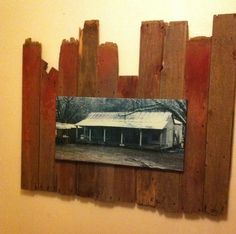 Picture of the house my grandpa grew up in- mounted on barn board. Over the fireplace in the master bedroom?