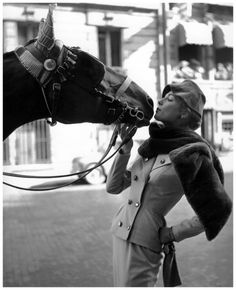 Fiona Campbell-Walter in a camel-hair suit with sheared fur stole by Marc Bohan, photo by Georges Dambier, ELLE, August 31, 1953