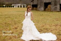 This is the dress that I refashioned from an old 70's era wedding gown to a more modernized gown! IT was fun and the Model is so beautiful. MUA and Photographer is True Bella Makeup Artisty out of Tennessee.  Gown is refashioned by Stephanie (me) at Kalli Alba Bridal Couture www.KalliAlba.com