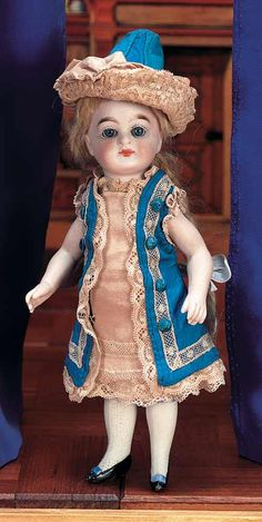 """German all-bisque 7.5"""" mignonette with swivel head on a bisque body with kid lined joints and fancy blue-bow shoes. c.1890"""