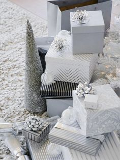 Creative idea from The Paper Mulberry : cover a foam cone with grey sequins and glitter - pretty grey and white Christmas wrap