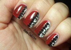 Red and White Stamped Nails with Black Rhinestones