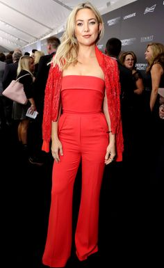 Kate Hudson in a red strapless Elie Saab jumpsuit and sequin bomber jacket