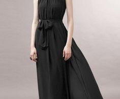 This elegant black chiffon maxi dress featuring glamorous flounced high neck with back ties, sleeveless styling, belt is included. spenditonthis.com