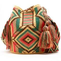 The Wayuu women are incredibly talented at crocheting beautiful wayuu bags and patterns. To the Wayuu, the patterns tell the story of their