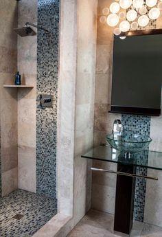 A mosaic strip adds a nice design to any bathroom.