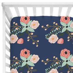 We adore the blush and mint flowers on a navy background in this adorable floral crib sheet. Create a navy nursery you love with this amazing dark floral print.