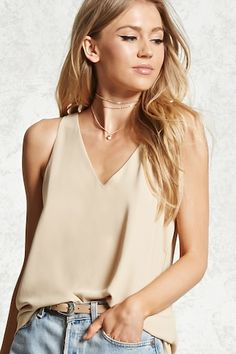 Style Deals - This crepe woven top features a sleeveless cut, V-neckline, a buttoned keyhole back, and a billowy silhouette.