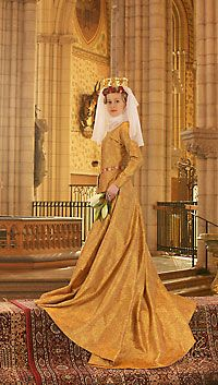 """Article on the recreation of the golden gown of Queen Margareta of Denmark, including recreation of the fabric.  The original gown is the only surviving/intact """"evening gown"""" from the time."""