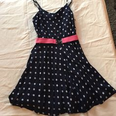 ✂️Navy and White Polka Dot Dress Navy blue dress with white polka dots. Spaghetti strap style. Very flowy and soft for a comfortable fit. Comes with the pink belt (which can be unattached if desired). No signs of wear, stains, or damages of any sort. Smoke-free home. Dresses Mini