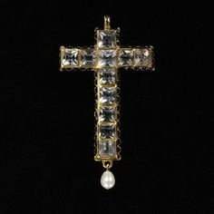 Spanish Pendant cross |   Place of origin: Spain (made) Date: ca. 1620 (made) |  Materials and Techniques: Rock crystals set in gold with enamel decoration and hung with a pearl |  Museum number: M.122-1975