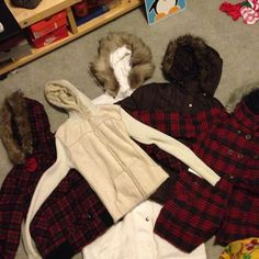 Last chance!!! 5 Jacket/coat bundle Cream: light weight but thick, knitted, fur inside, suede outside, XS. White: trench puffy coat rain proof, waist cincher, detachable hood and fur, S-M    Brown: puffy jacket, belt, detachable hood, XS-S.  Plaid jackets: one has toggle closure buttons, and is shorter in length, silk inside, NWT , xs-S.  Other plaid: pea coat style with furry/ fuzzy inside, detachable hood, xs-s North Face Jackets & Coats
