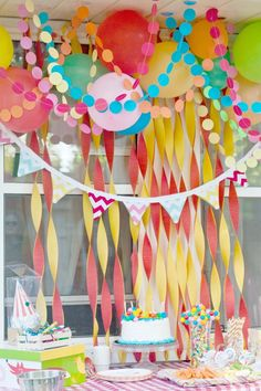 create your own Easter backdrop using crepe papers in yellow and red. decorate with different paper crafts such as circle garlands and flag pennant banner! don't forget to add your balloons too!