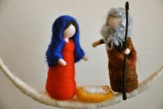 This is a Waldorf inspired piece made of wool by the needle-felting technique. Its been created to provide a peaceful and harmonious image that communicates with the soul through its colors, textures, forms and energy. Dimensions: 4 in Marie , Joseph and the angel. Circle 19in hight,10in