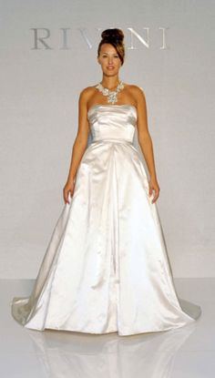 """Rivini by Rita Vinieris - """"Oria"""" has big time bling neckline and is on sale at the Ashton Station Bridal Sample Sale from Sept to Oct Used Wedding Dresses, Wedding Gowns, Big Time, Bridal Boutique, Bridal Collection, One Shoulder Wedding Dress, Neckline, Bling, Beautiful"""