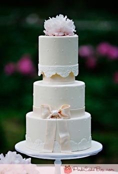 Wedding Cake - add height with dividers like pillars or cake dummy.  Lace to bottom edge.