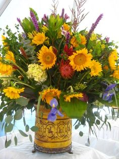 Fall is in the air! I celebrated by creating this fall arrangement highlighting sunflowers!  www.markballard.com