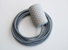 Handcrafted concrete pendant lamp with stylish textile cord.  light grey + zebra