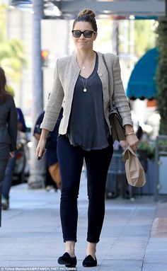 Stylish: The beauty added a touch of class with a tailored jacket with big buttons and wore her hair up into a sleek bun