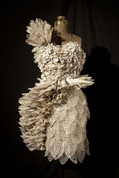 Artist Carrie Ann Schumacher creates these amazing dresses from the pages of books..... and a hole puncher! Love the creativity!