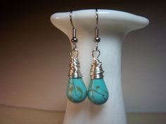 Check out this item in my Etsy shop https://www.etsy.com/listing/103802613/earringsturquoise-drop-dangles-silver