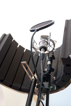 I like this shot because it shows the complexity (and downside) of relying upon a U-shield to isolate a microphone.  In a well treated space this is fine, but my complaint has always been the complexity of mounting (and mounting a copy stand) and the inability to invert the microphone for VO.