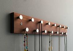 """A little piece of history preserved, this nicely crafted recycled wood jewelry rack provides a beautiful and orderly way to keep your jewelry easily accessible! A nice size to mount above the dresser, nightstand, or bathroom, 15"""" long with 15 smooth metal pins to hold necklaces, rings, and bracelets..... #Holder #Jar #Jewelry #jewelry organizer diy shelf #Mason #Necklace #Organizer #Shelf . . . learn how to make this fantastic master piece step by step at home, Tap Visit or link on this pin Jewelry Rack, Diy Jewelry Holder, Jewelry Box, Necklace Holder, Girls Jewelry, Jewelry Armoire, Jewelry Stores, Jewelry Scale, Jewelry Displays"""