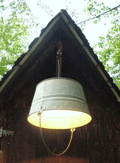 """Meet """"Washer""""!, a former wash bucket from southwest Virginia who is now respectfully displaying himself upside down as a pendant light. Read his story here...$90"""
