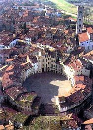 Lucca, Italy.  Cool Shot.  This is a view of the Amfiteatro.  In medieval times it was the amphitheater.  It retains its original shape and a lovely place for a gelato and evening passeggiata.