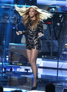 Beyoncé wearing a long sleeve body con printed mini dress and stiletto heels
