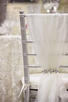 Silver chiavari chair with white and rhinestone chair cover - love this instead of traditional tie.