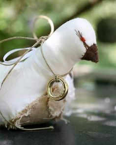 A friend of the couple's crafted a pair of birds to attach the rings to during this real wedding ceremony