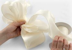 There are many ways to do it, but here's an easy-to-follow tutorial on how to make a pretty bow.