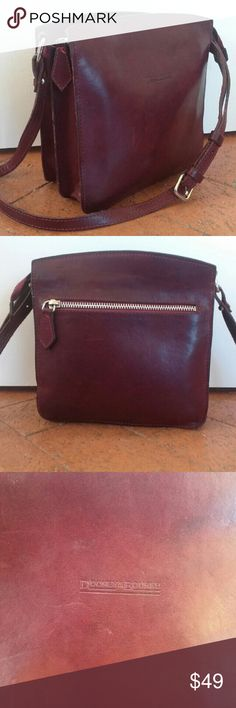Vintage Dooney & Bourke Leather Crossbody Beautiful vintage crossbody bag from Dooney & Bourke in a rich dark plum colored leather. the lining is navy with exposed suede on the sides and under the zipper flap. One zip pocket on the back, two interior compartments with another small zip pocket. Excellent preloved condition, with some minor scratches in the leather and some fading in the lining.  Height: 7.75 inches Length: 7.75 inches Depth: 4 inches Strap drop: adjustable, 20.5 to 23.5…