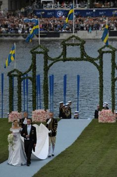 Crown Princess Victoria of Sweden and Prince Daniel of Sweden (R) arrive at the Royal Palace after a ride on the Royal Barge 'Vasaorden' after their wedding in Stockholm, 19 June 2010