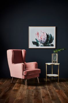 High Drama - This beautiful high backed, winged velvet Melina Armchair with its simple but sleek legs will add a touch of luxury to a bedroom or living room.