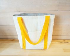 Tote bag - ivory white with outside pocket and yellow straps