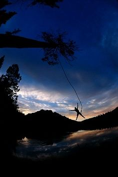 Rope swings into awesome lakes at sunset. Sounds relaxing :)