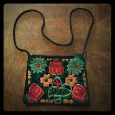 Mexican Velvet Embroidered CrossBody Bag I purchased this in Tijuana, Mexico. It is the perfect bag for all of your important Escentuals like make up, money, keys and your cell phone. I use this back a couple of times to go out. It is perfect for festivals. All of my items come from a teacup chihuahua's smoke & odor free home. If you have any questions do not hesitate to ask, I am online daily. Bags Crossbody Bags